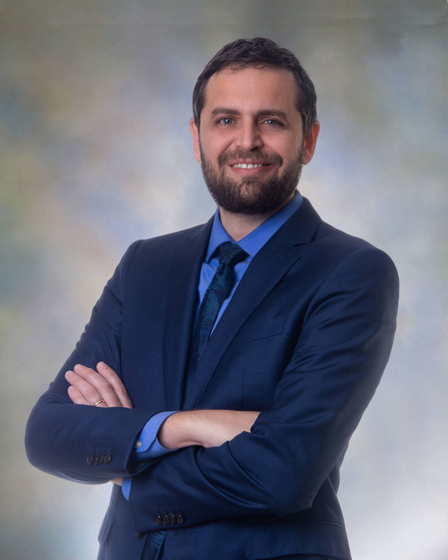 Justin Attorney At Law with custom pastel background, blue suit and shirt dark blue tie
