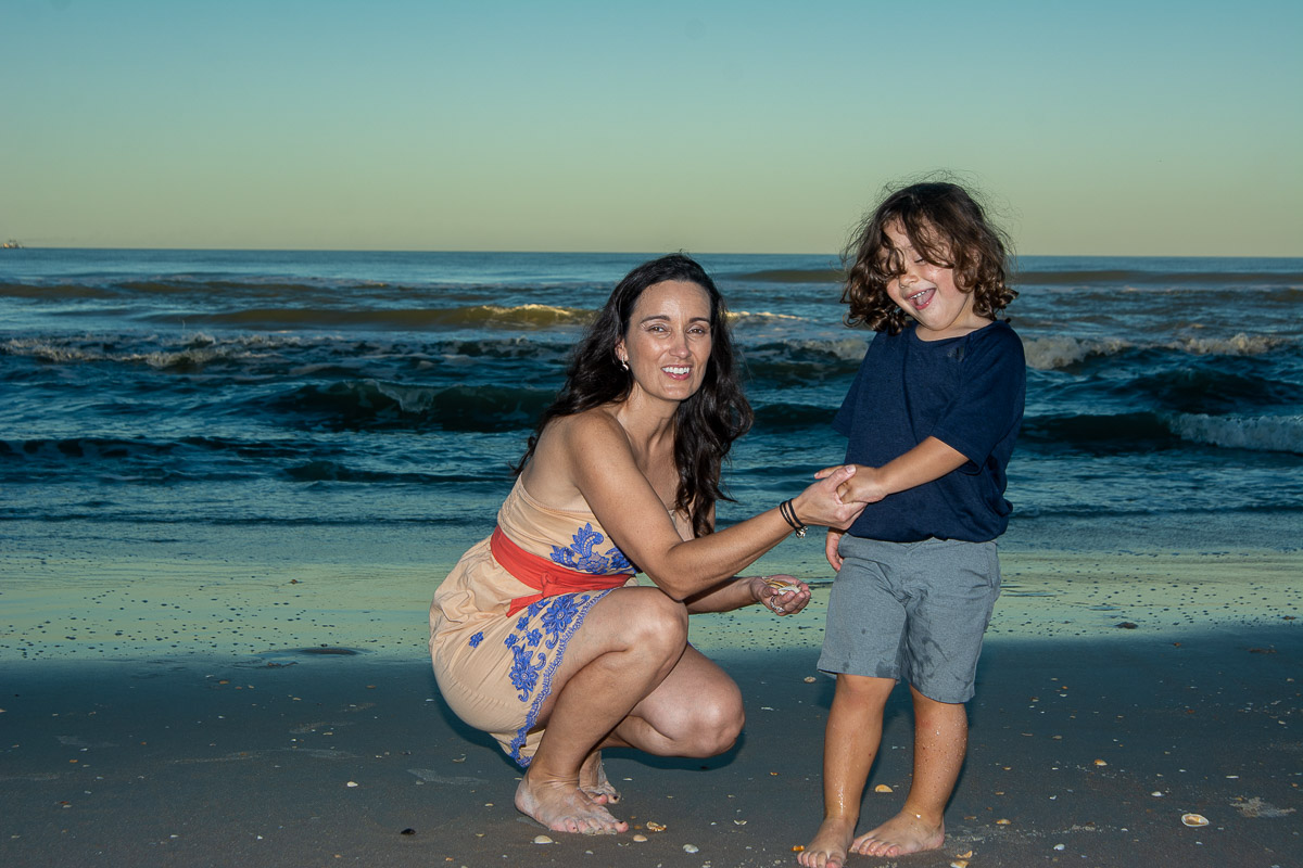 Mother and son portrait beach sunset waves background at sunset