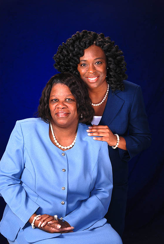 Blue background with Reverend mother and daughter in blue