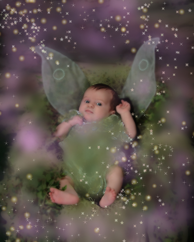 a small fairy baby with wings in a Forrest, nest with with twinkling lights