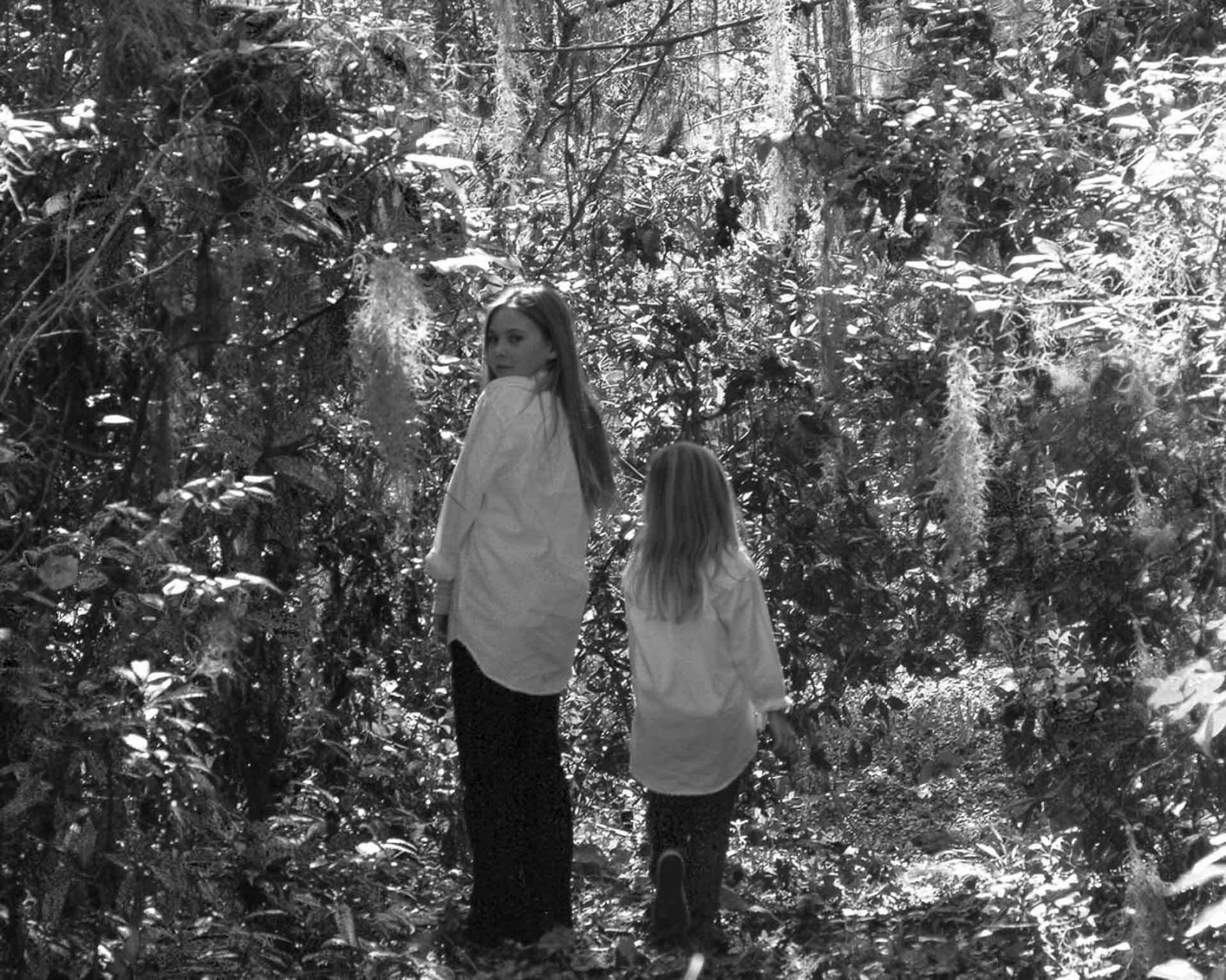 Children-walking-in-the-woods-black and white image